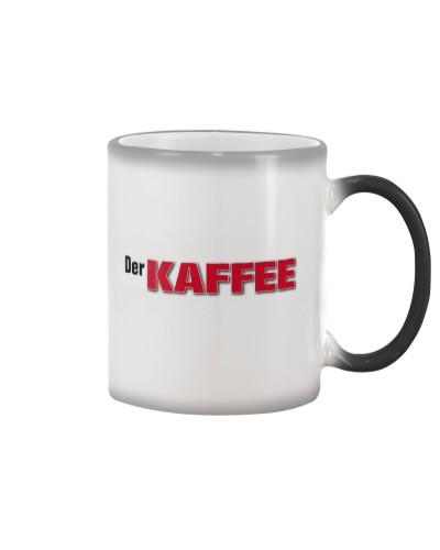 Die TASSE der warm wird zum Kaffee Der KAFFEE
